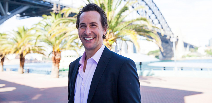 Shore co-owner Ben Wilcox in front of the Sydney Harbour Bridge