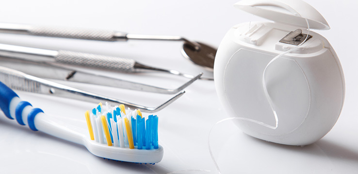 dental tools on white background toothbrush, floss, picks and mirror